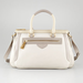For something a bit more subdued, check out this Marc by Marc Jacobs cream satchel ($528). It would look amazing as a Winter-white bag, as well as a fresh Summer purse.