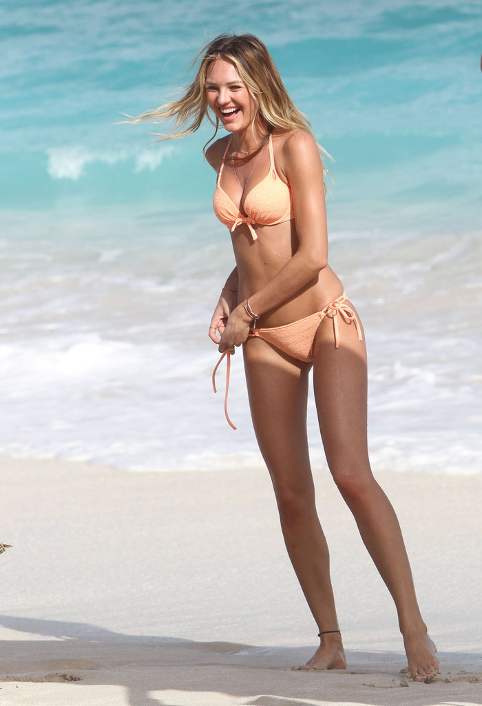 Candice Swanepoel was hard at work at a Victoria's Secret shoot in the brand's sweet peachy-hued bikini.