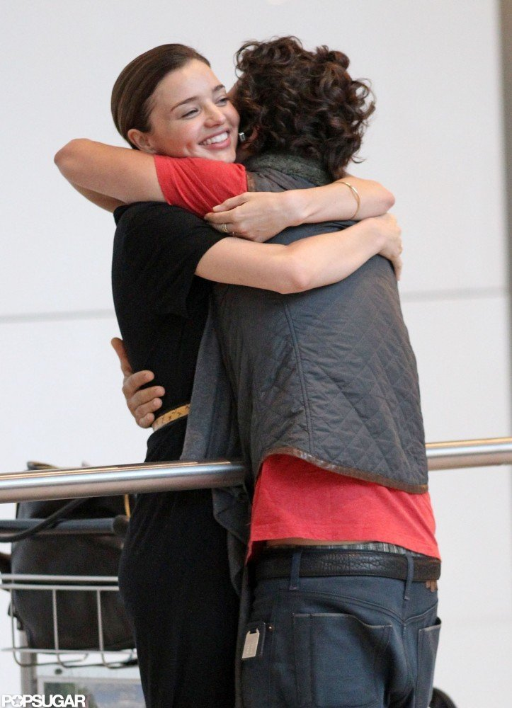 Orlando Bloom hugged Miranda Kerr upon arriving at London's Heathrow Airport in July 2010.