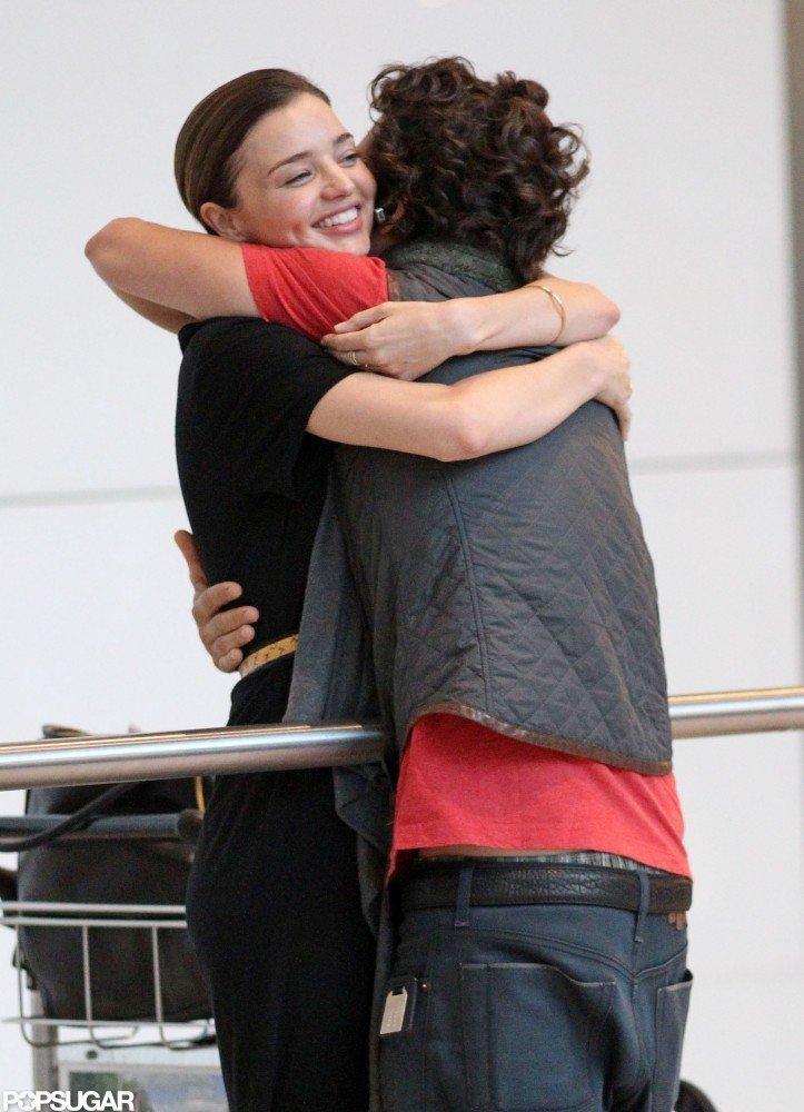 Orlando Bloom hugged Miranda Kerr upon arriving at London's Heathrow Airport in July 2010.