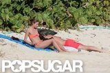 Olivia Palermo and boyfriend, Johannes Huebl, lay on the beach together in St. Barts.