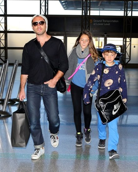 Jude Law Takes His Kids on a Flight Out of LA