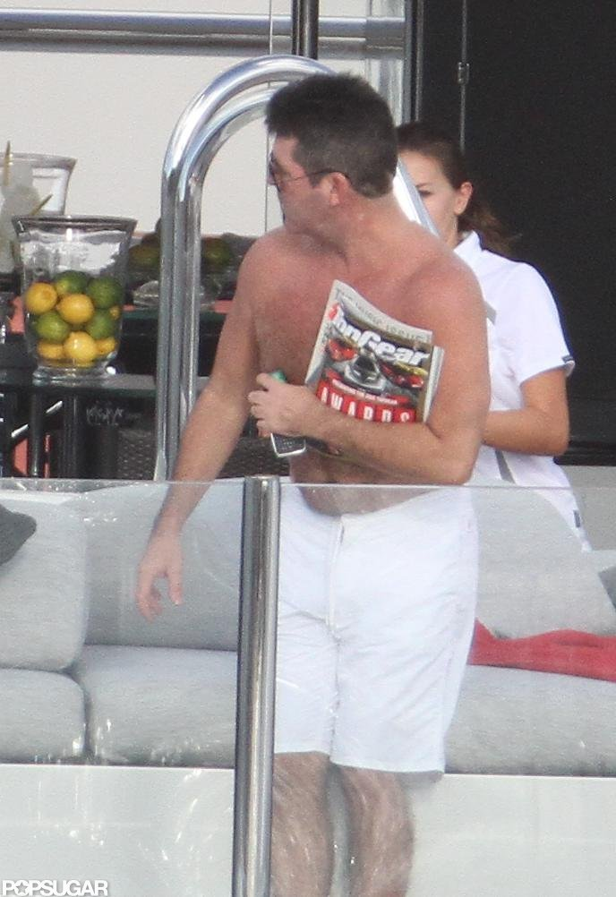 Simon Cowell tanned shirtless on a yacht.