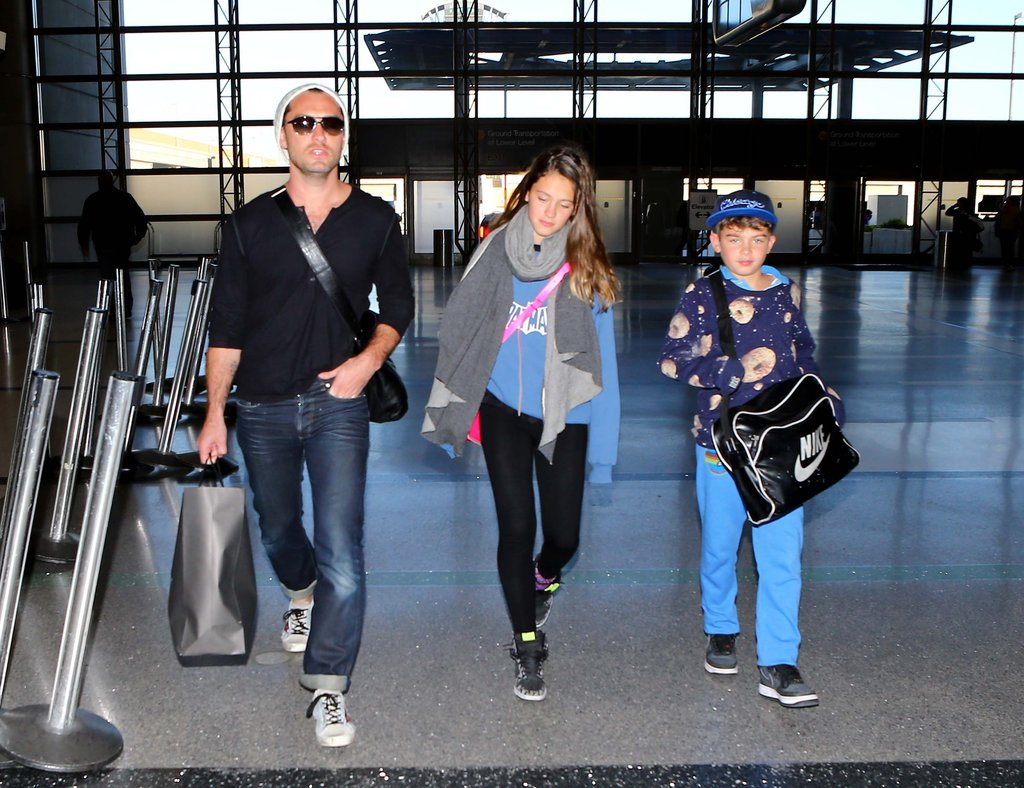 Jude Law walked his children to the security line.