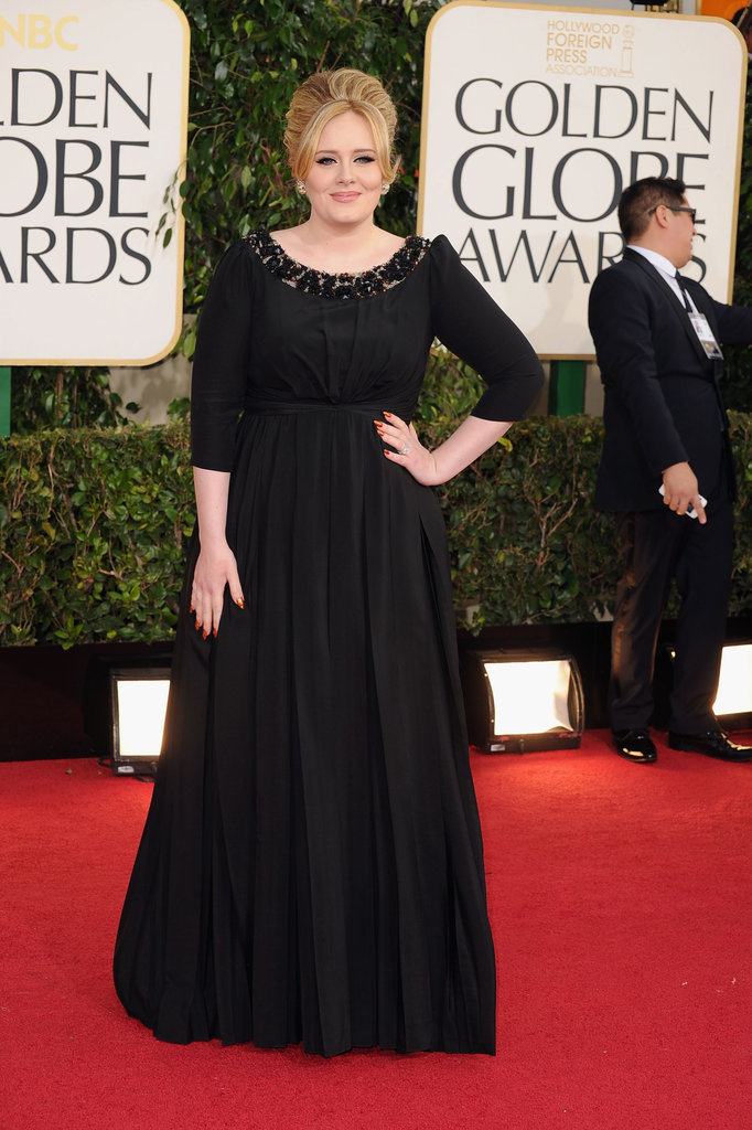 Adele smiled on the Golden Globe carpet before winning the award for best original song.