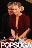 Amy Poehler sat on George Clooney's lap.
