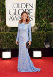 Nicole Richie kept warm in a long sleeve dress during the California cold Sunday night at the Globes.