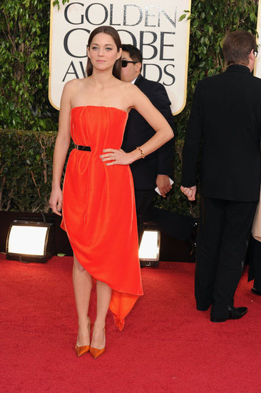 Marion Cotillard wore a red Christian Dior Haute Couture dress.