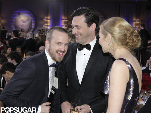 Aaron Paul smiled for the camera with Jon Hamm and Jennifer Westfeldt during a quick break at the Golden Globes.
