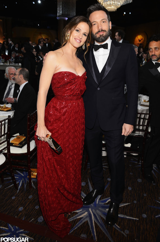 Jennifer Garner and Ben Affleck posed together as they made their way to their table.