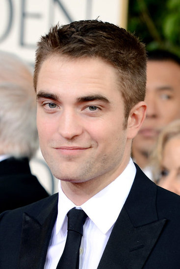 Robert Pattinson smirked for the cameras Sunday night.