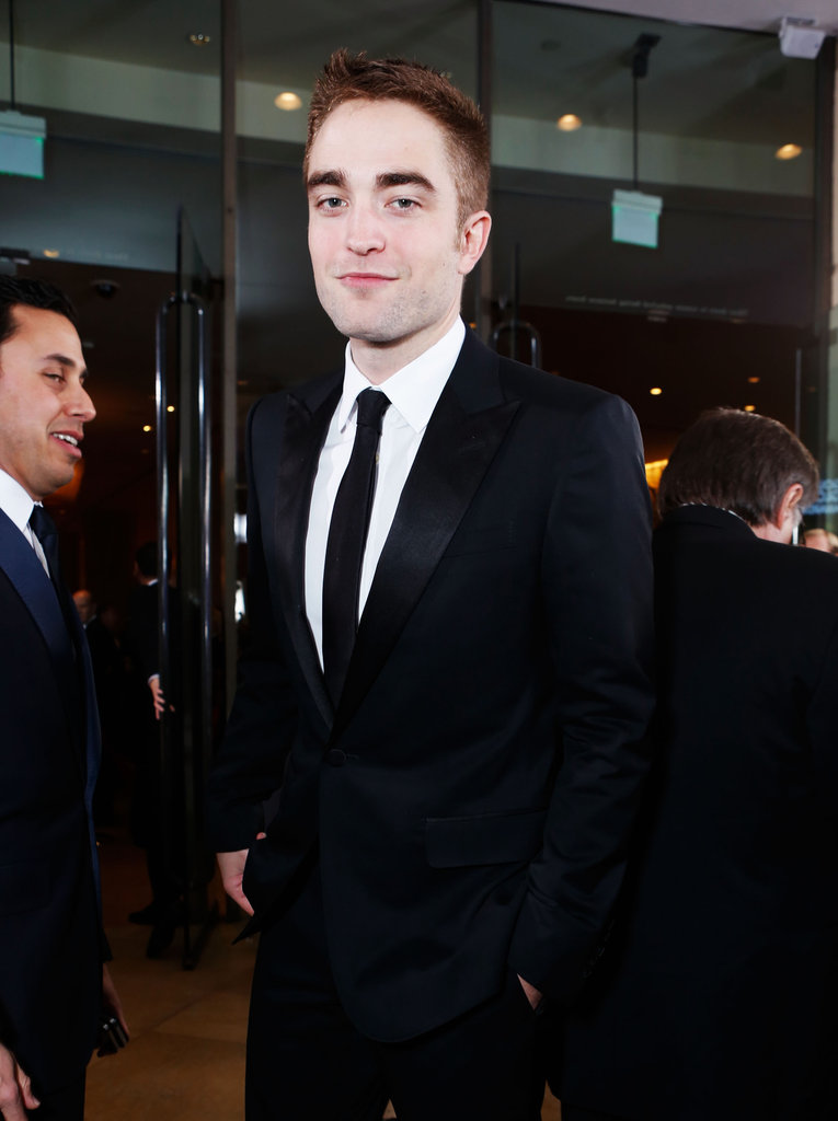 Robert Pattinson Poses Solo Ahead of His Globes Presenting Duties