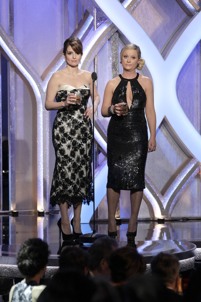 Amy Poehler and Tina Fey wore black and white dresses during one of their bits.