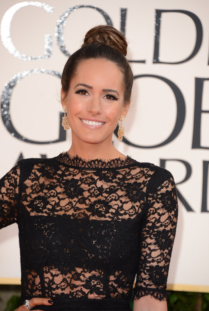 Louise Roe pulled her hair back in a clean ballet bun. The star chose a black lace dress for the event.