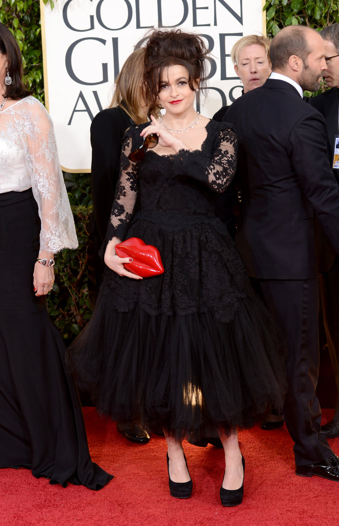 Helena Bonham Carter chose a lack lace dress and a spunky red lip clutch for the Golden Globes carpet.