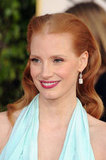 A close up of Jessica Chastain as she smiles for fans on the red carpet.