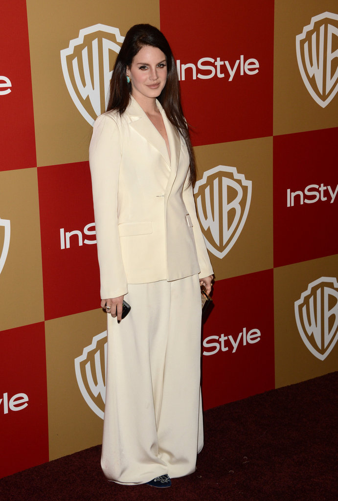 Lana Del Rey worked it in an ivory oversize Houghton suit, then finished the menswear-inspired look with blue smoking slippers.