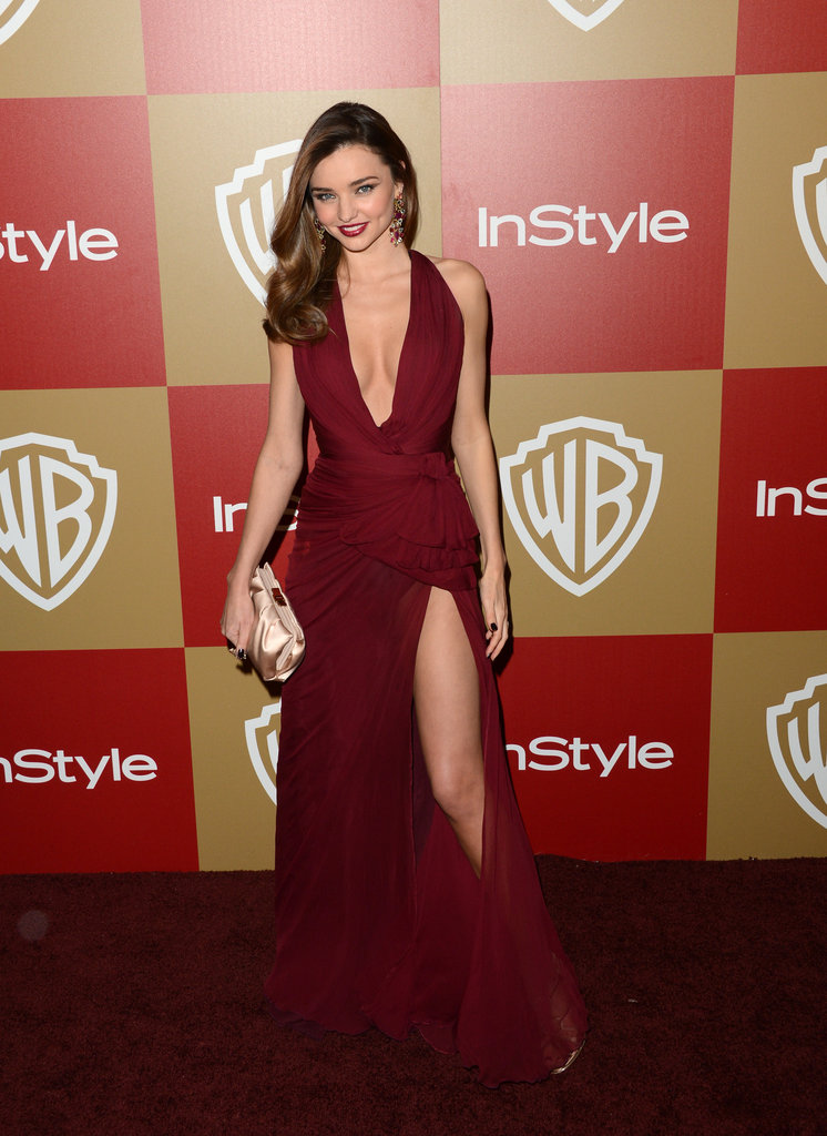 Miranda Kerr was first spotted at the Globes in this dark berry-hued Zuhair Murad gown. Between the thigh-high slit and daring V front, there's no question that Miranda owned this look from head to toe.