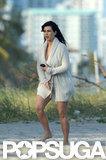 Kim Kardashian covered up on the beach in Miami.