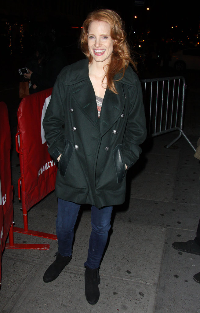 We love the slight military reference of her double-breasted forest green peacoat — and that's all you really need to make a statement. Low-key denim and flat boots polish off the look with an easy touch.