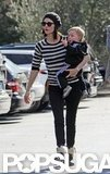 January Jones wore a striped shirt and hat for an outing with Xander on her hip.