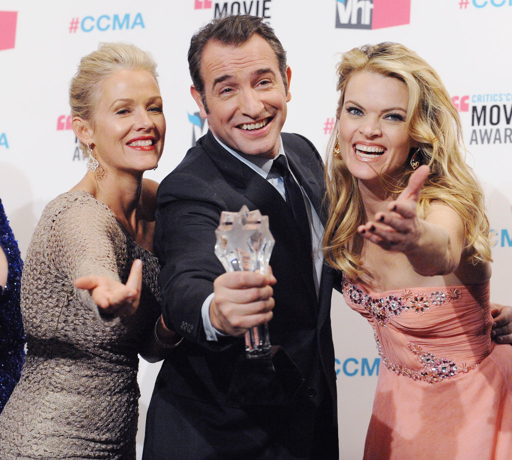 Jean Dujardin joked around with Missi Pyle and Penelope Ann Miller in 2012.