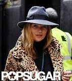 Kate Moss paired a leopard coat and trilby.