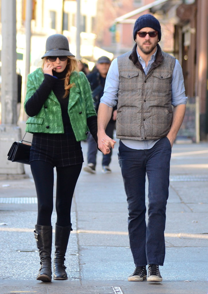 Blake Lively talked on her phone while walking with husband Ryan Reynolds.