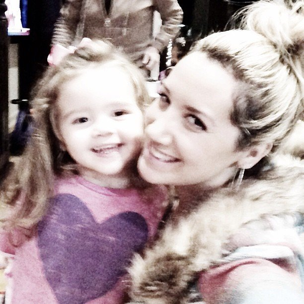 Ashley Tisdale posed with a young family member. Source: Instagram user ashleytis