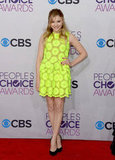 Chloë Moretz posed in a neon Simone Rocha dress.