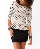 We'd wear this Forever 21 Polka-Dot Peplum Top ($16) with leather skinnies and d'orsay pumps for a sleek evening look.