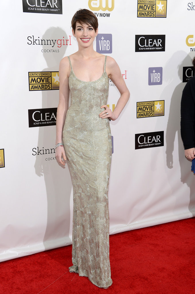 Anne Hathaway wore a metallic gold Oscar de la Renta number.