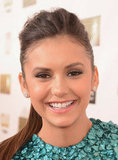 Nina Dobrev smiled on the red carpet.