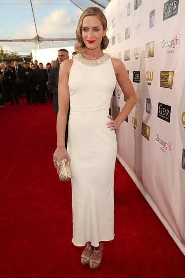 Emily Blunt wore a white Miu Miu dress.