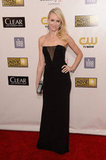 Naomi Watts wore a black Emilio Pucci gown with a sheer insert.