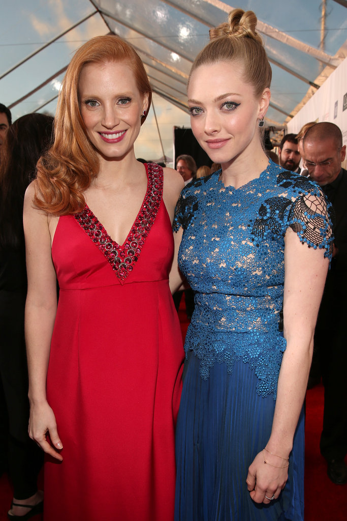 Best actress winner Jessica Chastain posed with Amanda Seyfried on the red carpet.