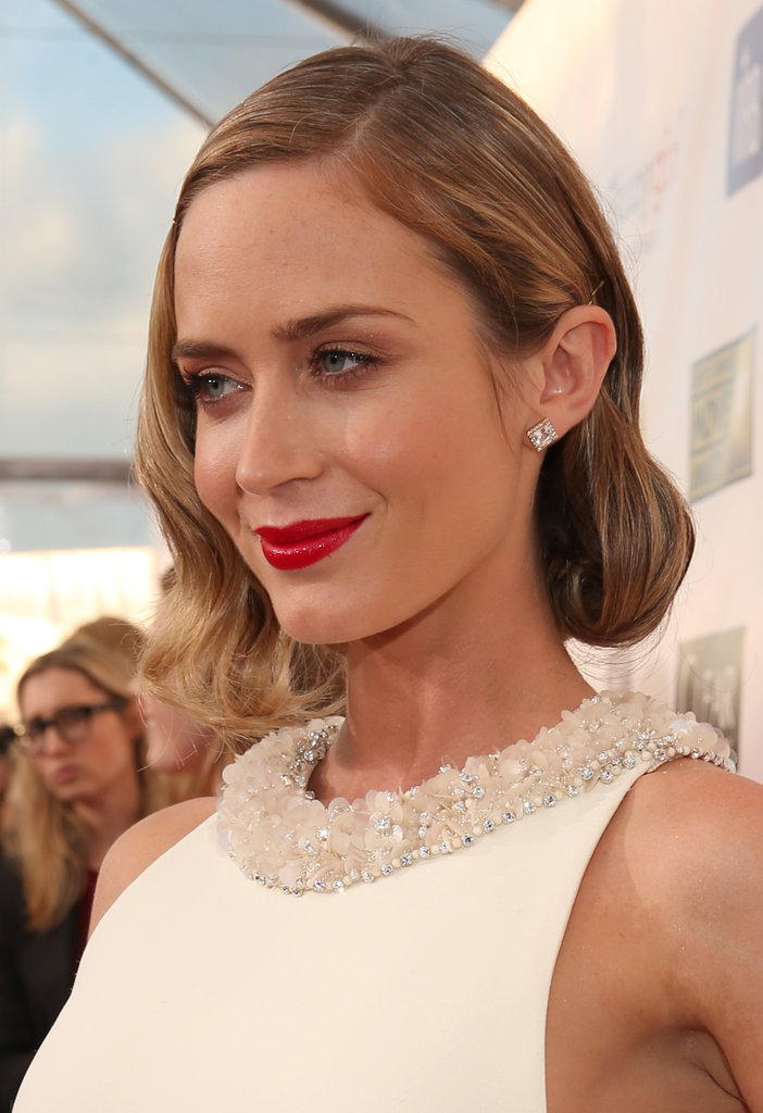 Emily Blunt paired her white Miu Miu dress with bright lips.