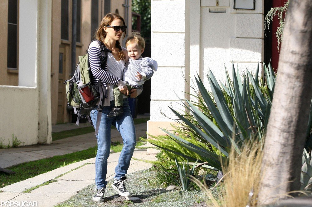 Natalie Portman carried a backpack and her son.