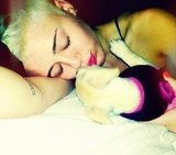 Miley Cyrus cuddled with her new puppy, Bean. Source: Twitter user MileyCyrus