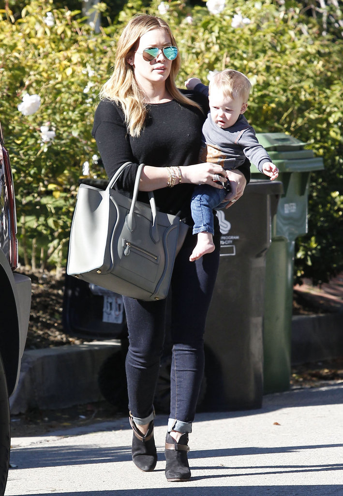 Hilary Duff crossed a street with Luca Comrie in her arms.