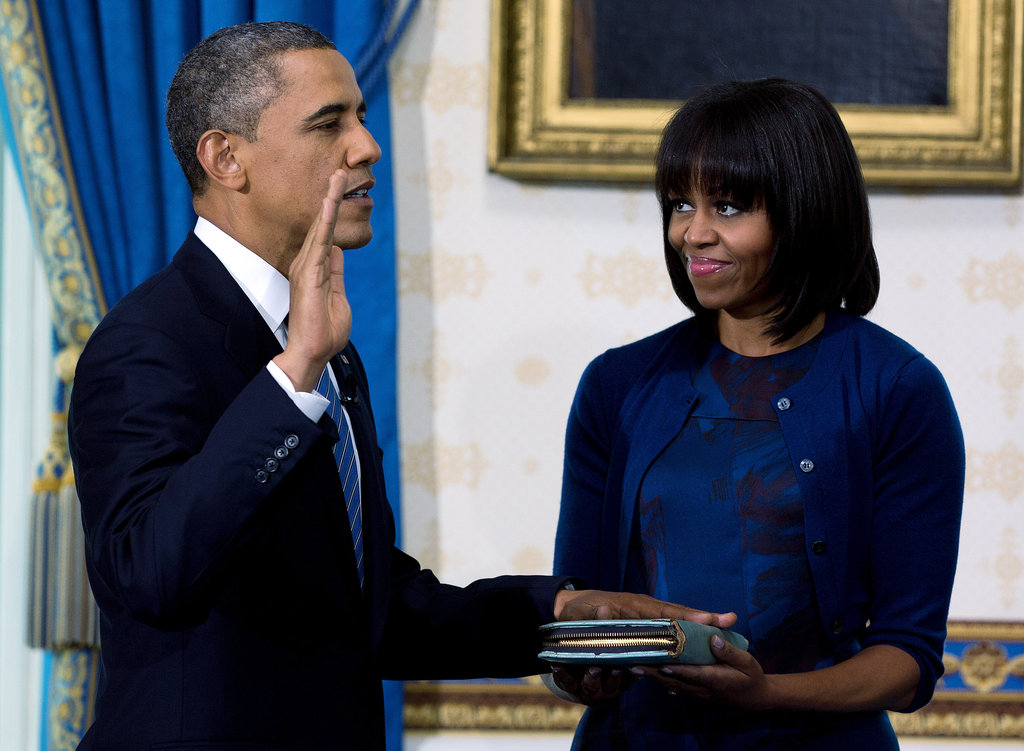 President Barack Obama took part in his private swearing-in while Michelle gave him a loving look.