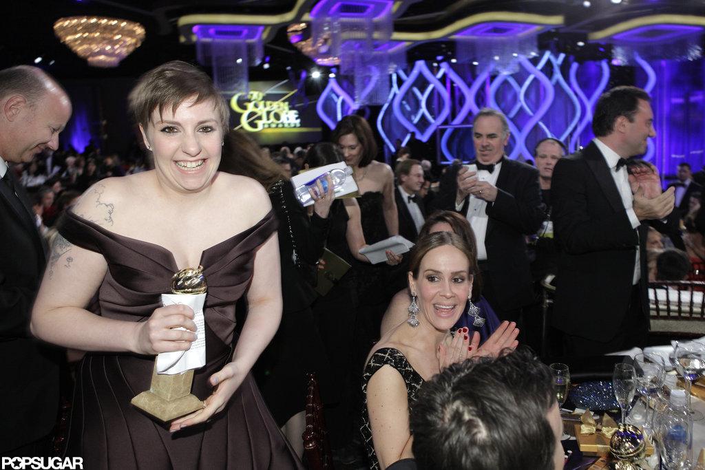 Lena Dunham smiled holding her Golden Globe.