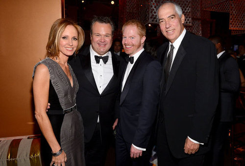 Eric Stonestreet and Jesse Tyler Ferguson smiled with Fox executives.
