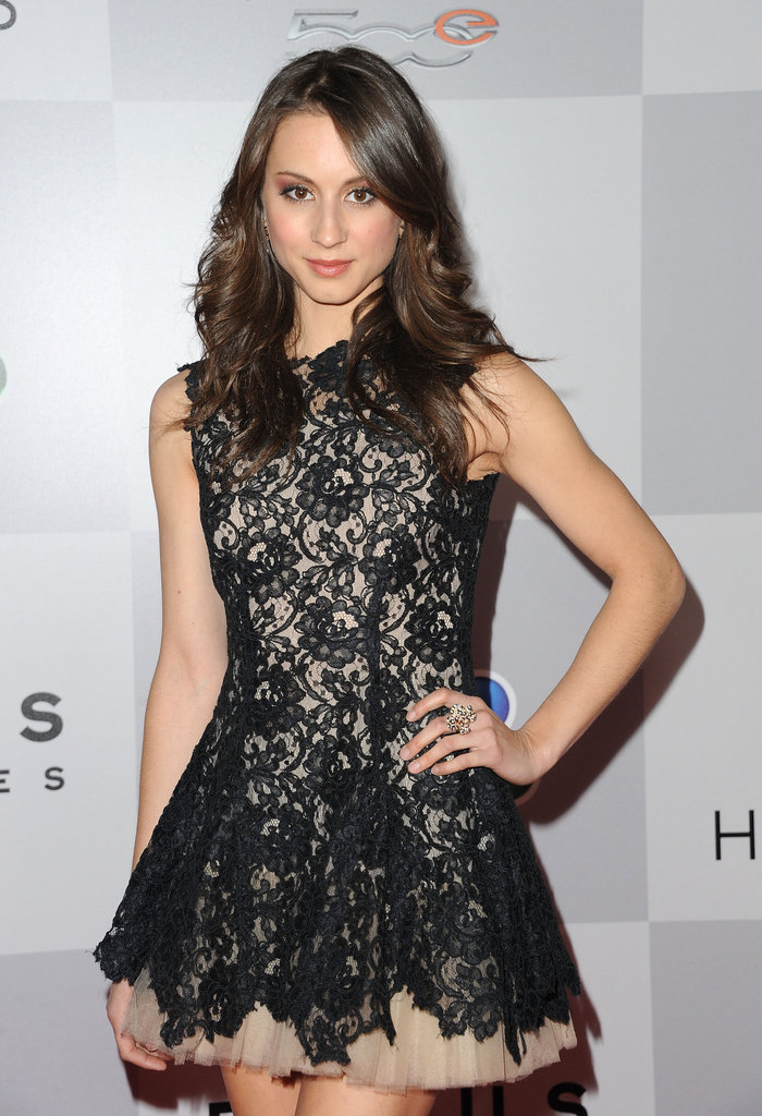 Troian Bellisario wore a black lace minidress.