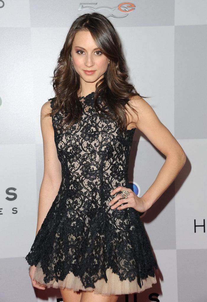 Troian Bellisario wore a black lace minidress.