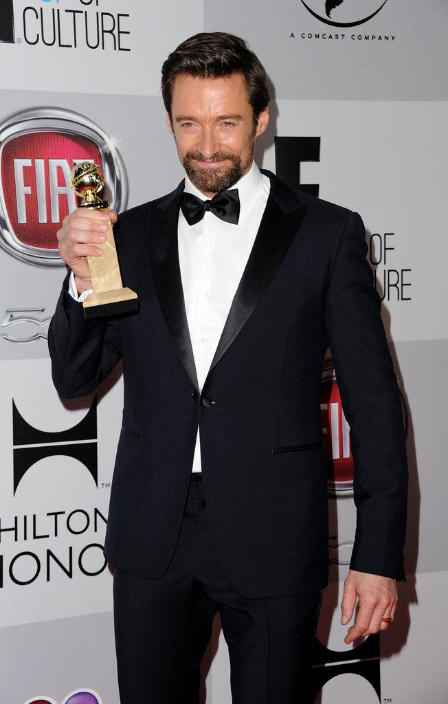 Hugh Jackman proudly held up his award.