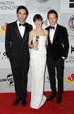 Anne Hathaway posed with Eddie Redmayne and Sacha Baron Cohen.