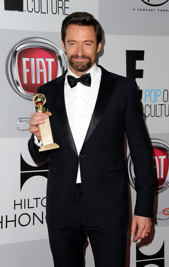 Hugh Jackman held up his award.