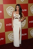 Shay Mitchell stepped out in a thigh-high split gown that also featured a gold-lined cut-out bodice.