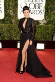 Eva Longoria got vampy in this black slit-to-there Emilio Pucci number.